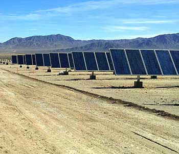 Photograph of an array of solar panels in the Chilean dessert