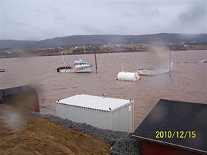 This photograph shows Nova Scotia's Margaree Harbour in 2010, after its wharf was breached by rising sea levels