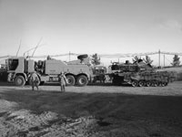 Photo of armoured heavy support vehicle system transporting a damaged tank