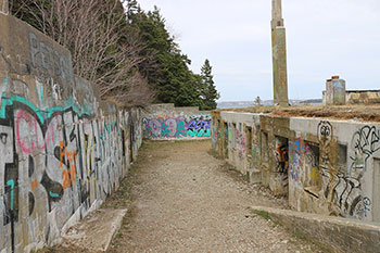 Exterior photo of the graffiti-covered World War II buildings at the York Redoubt National Historic Site in Halifax, Nova Scotia