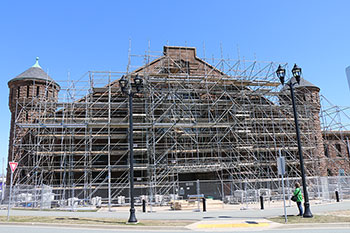 Exterior photo of the Halifax Armoury in Halifax, Nova Scotia, showing scaffolding for conservation work in progress